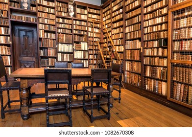ANTWERP, BELGIUM - MAR 30: Historical bookshelves full of antique books inside printing museum of Plantin-Moretus, UNESCO World Heritage Site on March 30, 2018. More 1,200,000 people lives in Antwerp