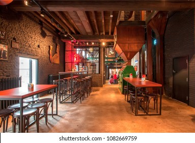ANTWERP, BELGIUM - MAR 30: Interior of empty bar with tables inside historical brewery with trademark De Koninck on March 30, 2018. More than 1,200,000 people lives in Antwerp
