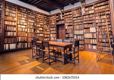 ANTWERP, BELGIUM - MAR 30: Library room with bookshelves with antique books in printing museum of Plantin-Moretus, UNESCO World Heritage Site on March 30, 2018. More 1,200,000 people lives in Antwerp