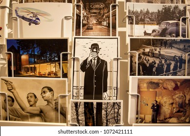 ANTWERP, BELGIUM - MAR 30: Many postcards with old images, parodies of the paintings of Rene Magritte and souvenirs on March 30, 2018. More than 1,200,000 people lives in Antwerp
