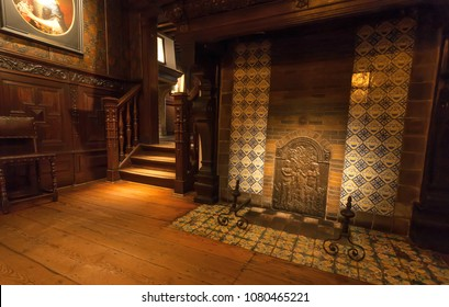 ANTWERP, BELGIUM - MAR 30: Old fireplace in room with wooden furniture, in printing museum of Plantin-Moretus, UNESCO World Heritage Site on March 30, 2018. More than 1,200,000 people lives in Antwerp
