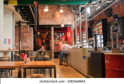 ANTWERP, BELGIUM - MAR 30: People buying beer at pub counter inside historical brewery with trademark De Koninck on March 30, 2018. More than 1,200,000 people lives in Antwerp