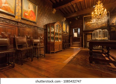 ANTWERP, BELGIUM - MAR 30: Room with vintage chandelier and antique furniture in printing museum of Plantin-Moretus, UNESCO Heritage Site on March 30, 2018. More 1,200,000 people lives in Antwerpen