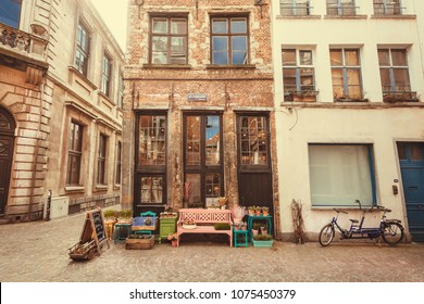 ANTWERP, BELGIUM - MAR 30: Small store in old style narrow street with restaurants of historical city on March 30, 2018. More than 1,200,000 people lives in Antwerp