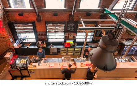 ANTWERP, BELGIUM - MAR 30: Top view on counter with beer drinking people inside historical brewery with trademark De Koninck on March 30, 2018. More than 1,200,000 people lives in Antwerp