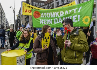 ANTWERP - BELGIUM - MARCH 11 - Six years after the Fukushima nuclear disaster Belgians and Dutch along the streets to demand the closure of nuclear plants in Doel and Tihange on March 11, 2017