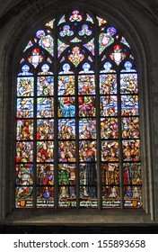 ANTWERP, BELGIUM - MAY 10: The stained glasses, describing scenes of the Saints' lifes of the Cathedral in Antwerp on May 10, 2006 in Belgium. Bell tower of the cathedral is UNESCO World Heritage Site