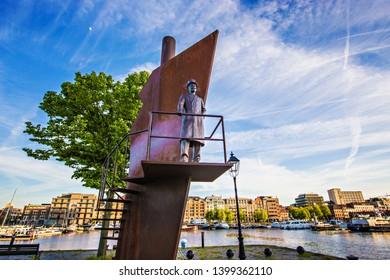 ANTWERP, BELGIUM - May 2019: The Captain monuments near the Museum aan de Stroom located along the river Scheldt in the Eilandje district of Antwerp, Belgium