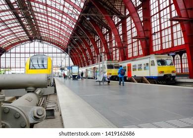 Antwerp, Belgium, May 2019,  Group of people walking to board train at Antwerp Central Station, Belgian. Antwerp Central is the main train station in the Belgian city of Antwerp.