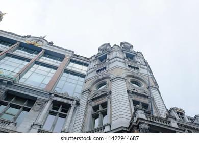 Antwerp, Belgium, May 2019,  Low-angle view of building of the Antwerp Central Station, Belgian. Antwerp Central is the main station in the Belgian city of Antwerp.