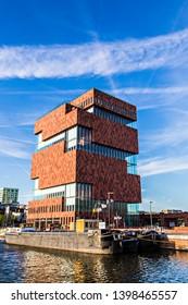 ANTWERP, BELGIUM - May 2019: The Museum aan de Stroom located along the river Scheldt in the Eilandje district of Antwerp, Belgium