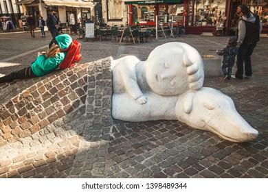 ANTWERP, BELGIUM - May 2019: Nello & Patrasche monument in Antwerp, Belgium. Boy sleeping with his dog monument in Antwerp center.