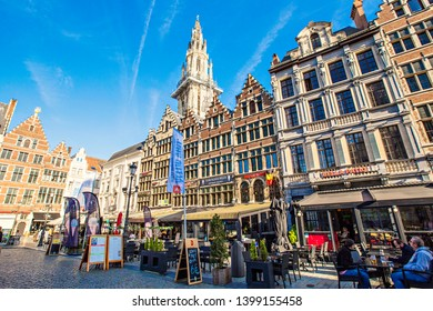 ANTWERP, BELGIUM - May 2019: Outdoor cafe and old buildings on the Grote Markt square in the center of Antwerp, Belgium