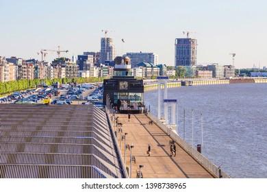 ANTWERP, BELGIUM - May 2019: Antwerp quay along the Scheldt river on sunny day, Belgium