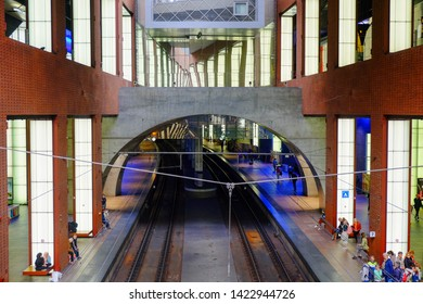 Antwerp, Belgium, May 2019,  Tourists and commuters waiting for train at the Antwerp Central railway station. Antwerp Central the main train station in the Belgian city of Antwerp.