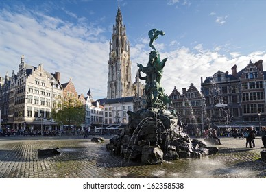 ANTWERP, BELGIUM - OCTOBER 26: The Grand Place with the Statue of Brabo, throwing the giant's hand into the Scheldt River and the Cathedral of our Lady.  on October 26, 2013 in  in Antwerp, Belgium.