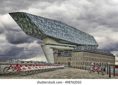 ANTWERP, BELGIUM - Oktober 14, 2016: New office port in the harbor of Antwerp , Belgium. Bicycle parking for rent.