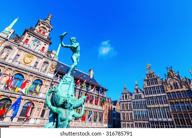 ANTWERP, BELGIUM - SEPTEMBER 02, 2015: bronze statue in front of the city hall in Antwerp. Antwerp is the capital of Antwerp province and with a population of 510,610 the most populous city in Belgium