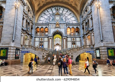 ANTWERP, BELGIUM - SEPTEMBER 20, 2014: Tourists and commuters in the beautiful historic Antwerp Central Station in Antwerp, Belgium, on September 20, 2014
