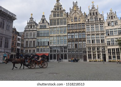 Antwerp, Belgium - September 23 2019: A horse drawn cart takes tourists through Grote Markt (the main market square of Antwerp) which is dominated by guild houses built in the 16th century