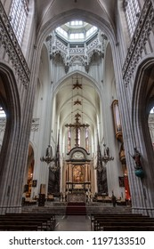 Antwerp, Belgium - September 24, 2018: Long shot on The Assumption of the Virgin Mary painting by Rubens above main altar in Onze-Lieve-Vrouw Cathedral of Our Lady. Pillars, arches, organ, benches.