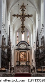 Antwerp, Belgium - September 24, 2018: The Assumption of the Virgin Mary painting by Rubens above main altar in Onze-Lieve-Vrouw Cathedral of Our Lady. Pillars, arches, cross, stables,