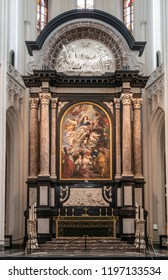 Antwerp, Belgium - September 24, 2018: The Assumption of the Virgin Mary painting by Rubens above high altar in Onze-Lieve-Vrouwe Cathedral of Our Lady, framed by pillars and crowned by fresco.