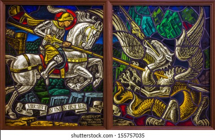 ANTWERP, BELGIUM - SEPTEMBER 5: Windowpane of duel of St. Georeg with the Devil in Joriskerk or st. George church on September 5, 2013 in Antwerp, Belgium