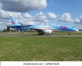 Antwerp, Belgium - September 8 2019: TUI Airlines Belgium Embraer ERJ-195 OO-TEA Departing/Taxiing/lining-up at Antwerp Airport Deurne in beautiful sunlight
