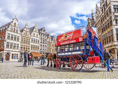ANTWERP, BELGIUM-APRIL 20, 2016: Belgian Flemish traditional house on the Grote Markt medieval square and the historic old retro carriage and team of horses in Antwerp, Belgium