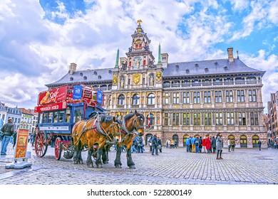 ANTWERP, BELGIUM-APRIL 20, 2016: Retro carriage and team of horses near City Hall on Grote Markt square in Antwerp, Belgium.