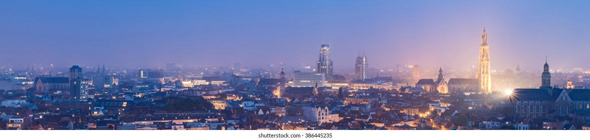 Antwerp City, Aerial View Cityscape Panorama Skyline with cathedral of our lady, St. Paul's Church at night under haze, Belgium