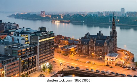 Antwerp City, Aerial View Cityscape Panorama Skyline with Pilotage Building, Bonaparte Dock, Ship, port area with river Schelde, Marguerie Schuilhaven under Haze at Night, Belgium