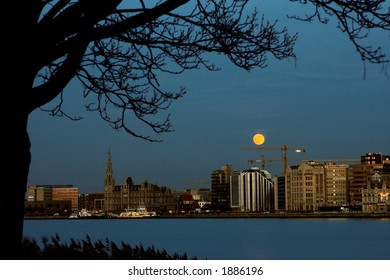 Antwerp city at full moon