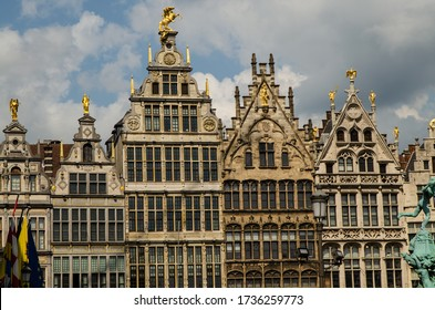 Antwerp, Flanders, Belgium. August 2019. On a beautiful sunny day detail of the facades of the guild houses in the town hall square. Elegant gilding embellishes the Renaissance architecture.