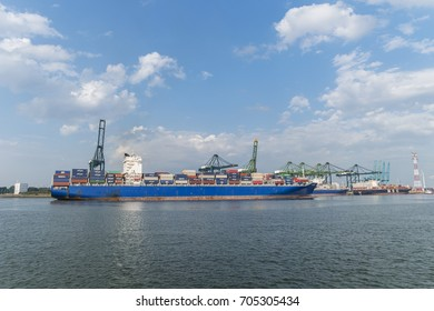 Antwerp Harbor Belgium August 2017, Harbor cranes  containers ships and oil tanker vessel on a sunny morning in the port of Antwerp.