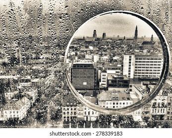 Antwerp through a glass porthole.