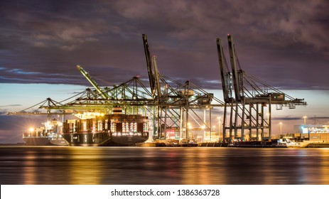ANTWERP-APRIL 26, 2019. Illuminated container terminal at twilight. Thanks to its very high productivity, Antwerp is one of the fastest growing container ports of the European industrial area.