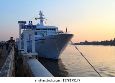 ANTWERPEN, BELGIUM - 19 NOVEMBER 2017: cruise ship in Antwerpen port, Antwerp harbor sunset