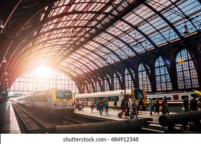 Antwerpen, Belgium - 9th September 2016 - Train and travelers in a railroad train station Antwerpen during sunset.