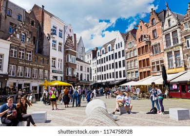 ANTWERPEN, BELGIUM - JUNE 04, 2017: View of historic houses and retro cafe on square against of the Cathedral of Antwerp Our Lady