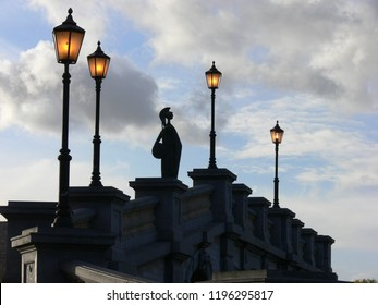 Antwerpen, Belgium - October 18, 2007: statue of goddess Minerva on a bridge surrounded by vintage lanterns