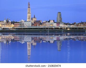Antwerpen skyline reflecting in river Schelde in the evening, Flanders, Belgium