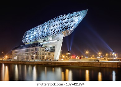ANTWERP-FEB. 15, 2019. Port House Antwerp at night. Zaha Hadid Architects added a glass extension to a renovated fire station. With a total of 12,800 square meters the headquarters houses a 500 staff.