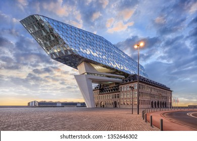 ANTWERP-FEB. 15, 2019. Port House Antwerp at dusk. Zaha Hadid Architects added a glass extension to a renovated fire station. With a total of 12,800 square meters the headquarters houses a 500 staff.