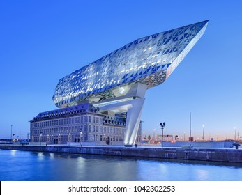 ANTWERP-FEB. 25, 2018. Port House Antwerp at dawn. Zaha Hadid Architects added a glass extension to a renovated fire station. With a total of 12,800 square meters the headquarters houses a 500 staff.