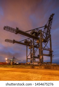 ANTWERP-JULY 15, 2019. Large crane at container terminal at nighttime. The Port of Antwerp in Flanders, Belgium is the second-largest seaport of Europe, after Rotterdam in the Netherlands.