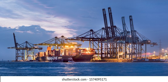 ANTWERP-JULY 26, 2019. Illuminated container terminal at twilight. Thanks to its very high productivity, Antwerp is one of the fastest growing container ports of the European industrial area.