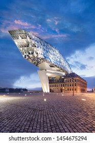 ANTWERP-JUNE 15, 2019. Port House Antwerp at twilight. Zaha Hadid Architects added a glass extension to a renovated fire station. With total of 12,800 square meters headquarters houses a 500 staff.