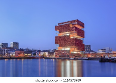 ANTWERP-JUNE 5, 2018. MAS Museum Antwerp at twilight. It is the biggest museum of Antwerp and one of the city's architectural highlights, located in an old harbor on a small island near Willmdok.